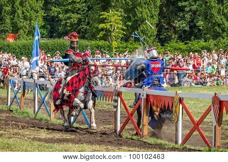 Two Horsemen Have Heavy Spears Contact At Jousting Tournament