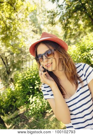 Teenage hipster girl talking on the cellphone