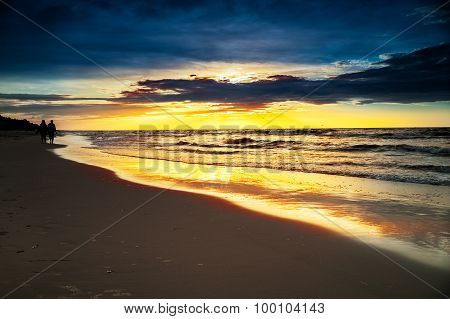 Hdr Image Of Couple Walking On Beach