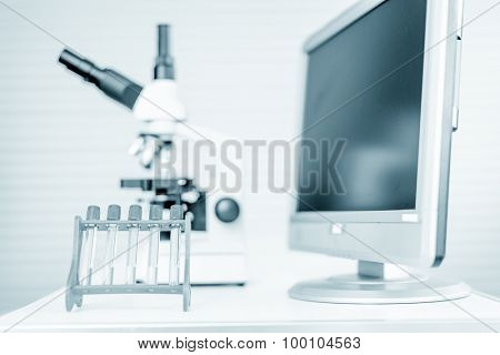 pipette and chemical glass in laboratory blue color