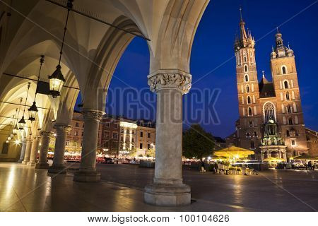 Krakow main square night view with column gallery