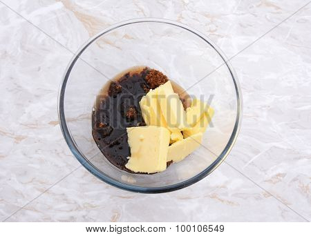 Maple Syrup, Butter And Dark Soft Sugar In A Glass Bowl