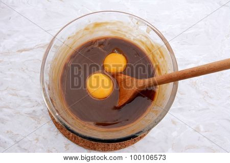 Stirring Egg Yolks Into Pecan Pie Filling