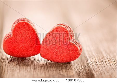 Two Red Heart Shaped Cookies, Extreme Close Up, Selective Focus, On Wooden Background