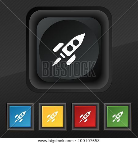 Rocket  Icon Symbol. Set Of Five Colorful, Stylish Buttons On Black Texture For Your Design. Vector
