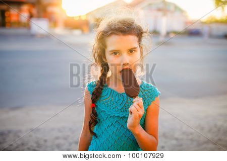 Teen girl eating ice cream in the summer the outside bites lifes