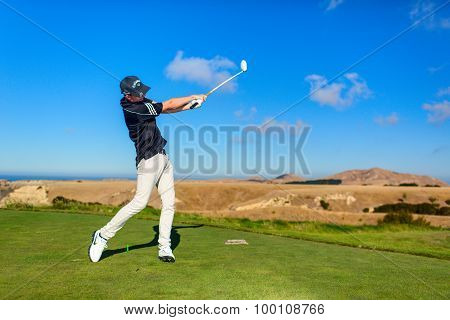 Golf player is practicing on the golf field. Cape Kidnappers golf court. New Zealand