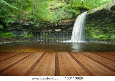 Beautiful Woodland Stream And Waterfall In Summer With Wooden Planks Floor