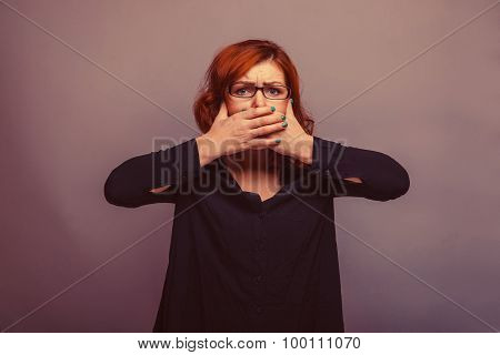 European-looking woman 30 years his hands over his mouth retro