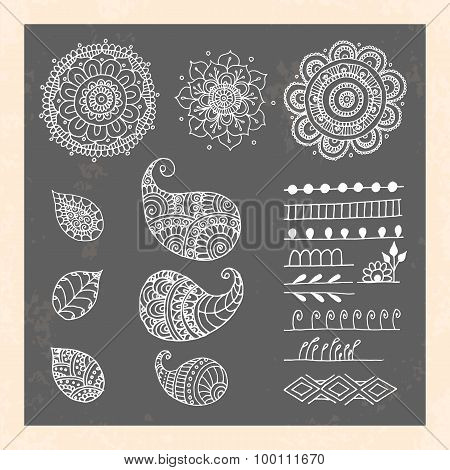 Henna tattoo doodle vector elements on black background.