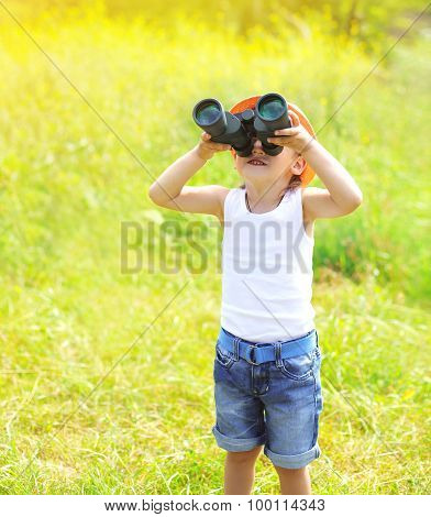 Sunny Photo Child Boy Looks In Binoculars Outdoors In Summer Day