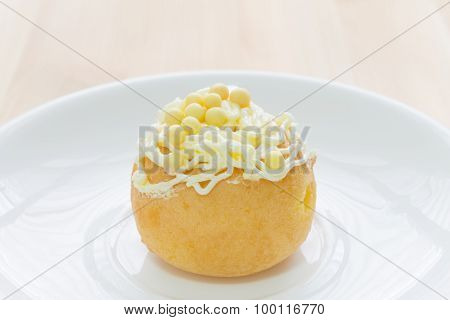 Yellow Choux Or Profiterole Or Eclair On Wood Table