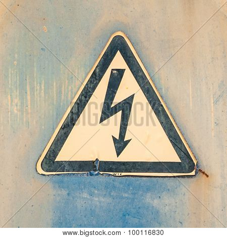 Rusty Old High Voltage Warning Sign