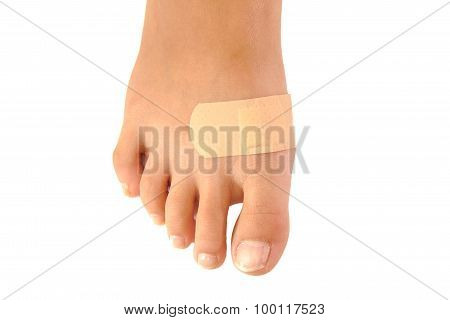 Close up of band-aid on a foot isolated. white background
