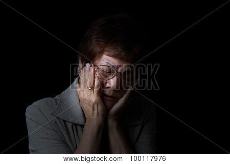 Senior Woman Holding Face While In Pain On Black Background