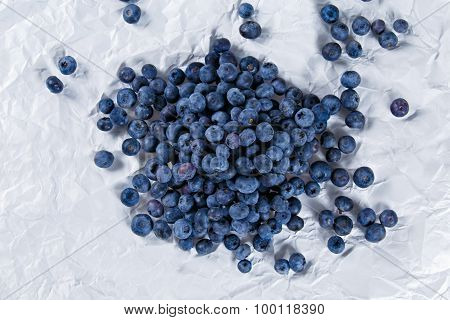 Fresh Juicy Blueberries on crumpled paper. Rich with vitamins.