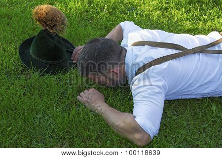 Bavarian Man Lying On The Grass
