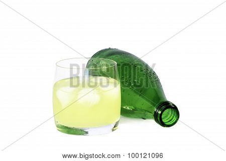 Glass Of Cold Lemon Drink With Ice And Next Bottle
