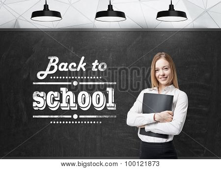 Young Lady With A Black Folder Is Thinking About Future Academic Year. Words: ' Back To School ' Are