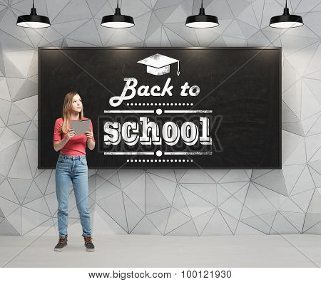 Young Lady Is Pondering About Future Academic Year. Words: ' Back To School ' Are Written On The Bla