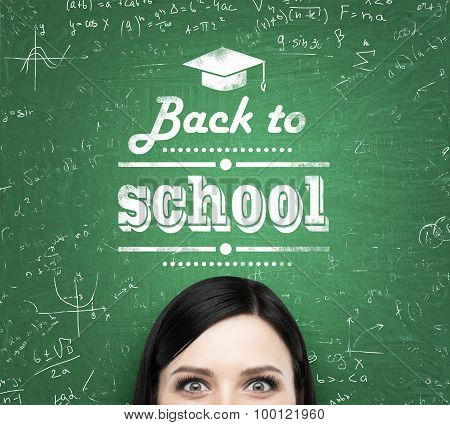 A Forehead Of The Brunette Girl And Words: ' Back To School ' Which Are Written On The Green Chalkbo
