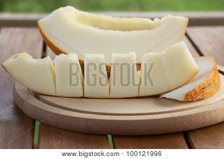 Slices Of Melon On Wooden Plate