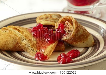 Pancakes With Red Currant Jam On Plate