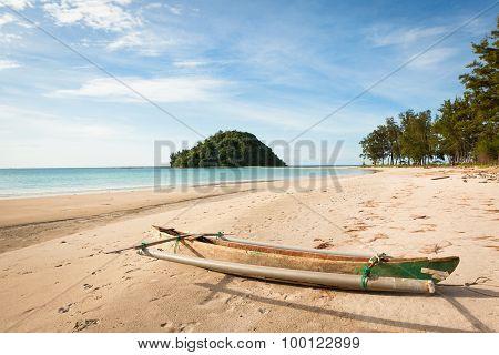 Small fishing boat exotic beach