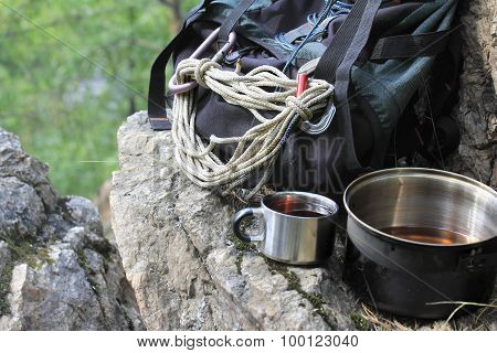 Backpack, Pot And Mug Of Tea On The Cliff Top