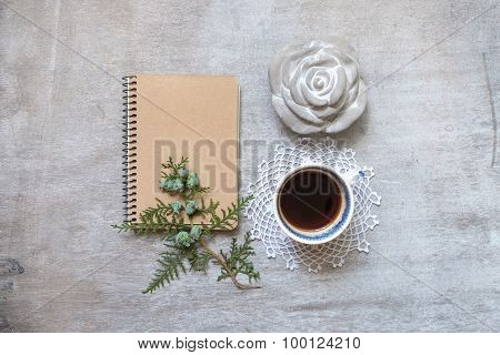 Cup Of Coffee With A Notebook