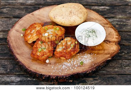 Fried Potato Pancakes Wich Soure Cream On The Old Wooden Background