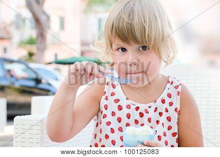 Caucasian Baby Girl Eats Frozen Yogurt, Closeup