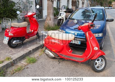 Classic Red Italian Scooters Parked On A Roadside