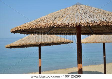 Beach Straw Parasols, Sea And Sky