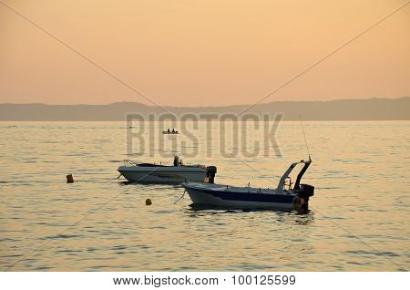 Two Boats On Sea In Sunset
