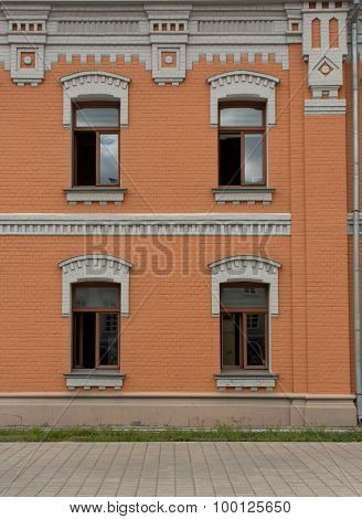 Facade Of The Building With Four Windows
