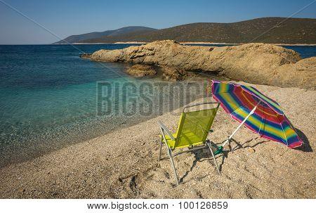 Beach Umbrella And Chair On A Sandy Beach Zastani, Evia