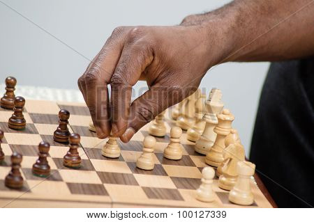 checkmate chess player placing his pawn.