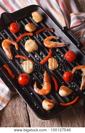 Shrimp And Scallops On The Grill Pan On The Table. Vertical