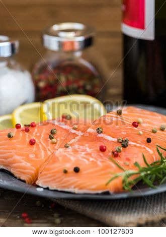 Raw Salmon Fish Fillet With Wine, Lemon, Spices And Fresh Herbs
