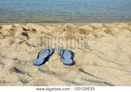 Blue Flip Flops On A Beach