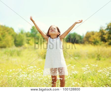 Happy Little Girl Child Enjoying Sunny Summer Day And Having Fun Outdoors