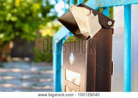 Mailbox with newspaper