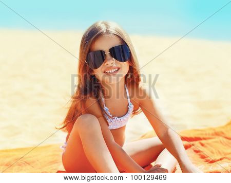 Portrait Of Little Girl Child In Sunglasses Relaxing On The Beach Summer