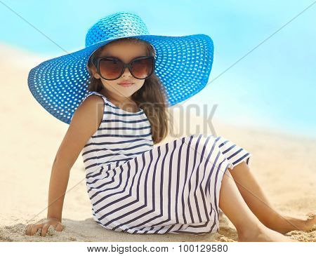 Summer, Vacation And Travel Concept - Portrait Of Pretty Little Girl In A Striped Dress And Straw Ha