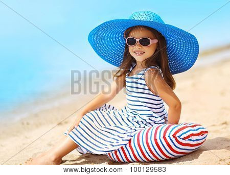 Summer, Vacation And Travel Concept - Portrait Of Pretty Little Smiling Girl In A Striped Dress And