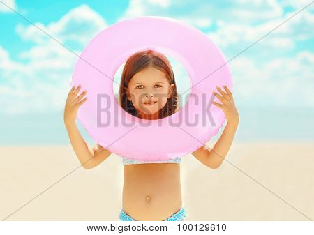 Travel, Leisure And Summer Vacation Concept - Portrait Of Little Girl Child With Inflatable Circle O