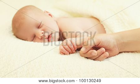 Baby Lying Sleeping On The Bed At Home And Hand, Focus On Hands