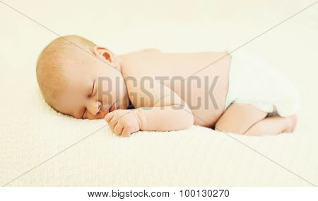Sweet Sleep Baby Lying On The Bed At Home