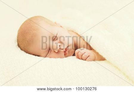 Sweet Sleep Baby Lying Under Blanket On The Bed At Home